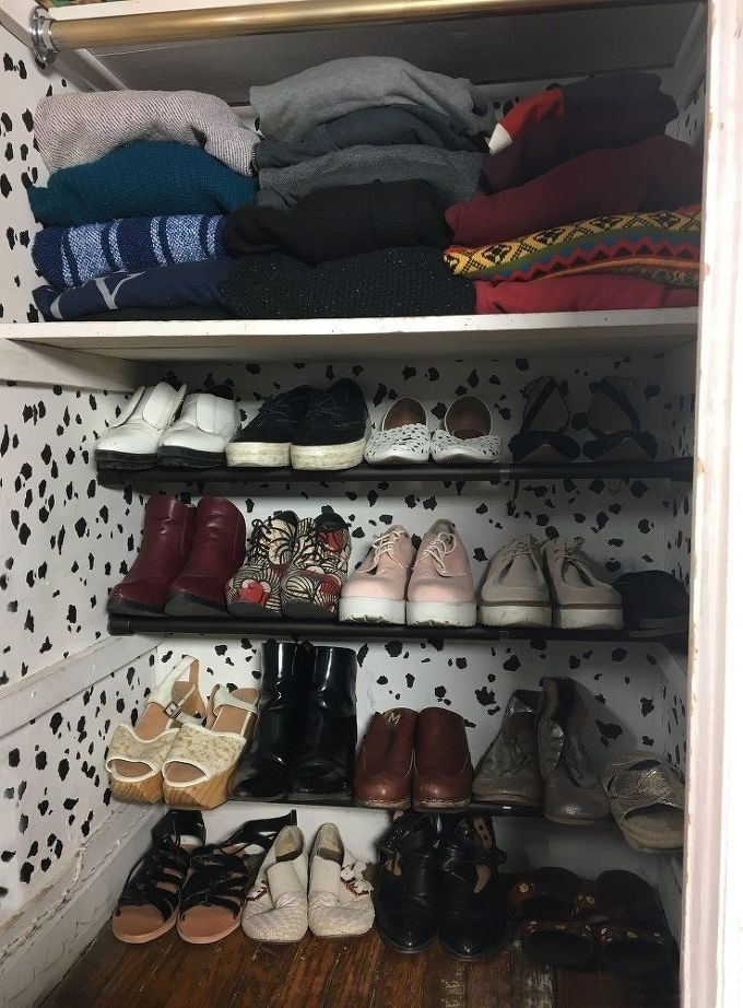Arrange and store your shoes in tension rods in a corner of the room